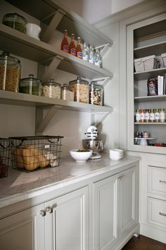 pantry shelving Fantastic kitchen pantry features light gray cabinets paired with Taj Mahal Quartzite placed under stacked gray shelving accented with corbels next to recessed pantry s Corner Pantry, Kitchen Corner, New Kitchen, Kitchen Ideas, Kitchen Decor, Vintage Kitchen, Kitchen Grey, Pantry Ideas, Awesome Kitchen