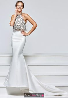 This beautiful Tarik Ediz two piece dress  93157 showcases a beaded halter crop top and slim skirt with long train.