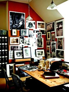 Collection Display: Photo Finish    A wall covered with black-and-white portraits makes a graphic statement in an office.