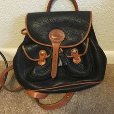 SALE New condition  Dooney and Bourke backpack Great condition new condition vintage Dooney  Bourke backpack.   H 11 by L  11 inches  by W 3 inches Dooney & Bourke Bags Backpacks