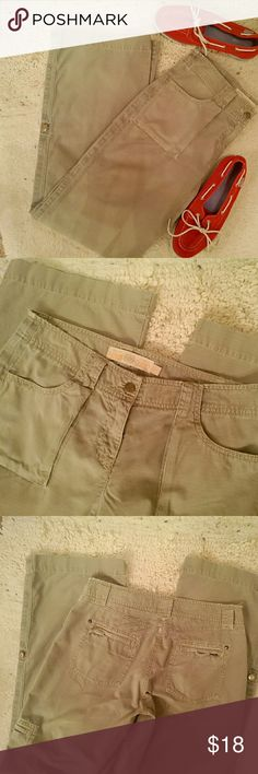"J Crew tan chinos cute pants that can be worn long or rolled up with a button strap; tan color; lots of pockets - front, back, and on the legs; J Crew brand; size 2; good condition but there are a few signs of wear - small areas of frayings, etc, ; inseam 32""  (T-12) J. Crew Pants"