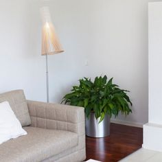 Secto 4210 is an elegant floor lamp with a slatted, wooden shade that fills the space with gentle light. The adjustable leg makes Secto 4210 a perfect companion for an armchair or desk. Adjustable Legs, Birch, Armchair, New Homes, Ceiling Lights, Elegant, Lighting, Design, Inspiration