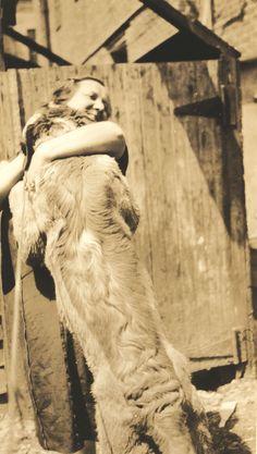Big Dog Hug - circa 1926 ♥  Big Dogs = Man's Best Friend / www.PetWellbeing.org