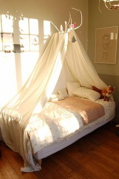 bed canopy - use hinged plant hanger/ swing closed/hang tulle, ribbons to create curtain