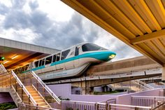 """https://flic.kr/p/YCCu4J   The Station Departure   Today's photo tour sends us to the ticket and transportation for a shot of monorail teal. I'm always looking for different ways to photograph this awesome form of Disney transportation other then my usual """"go-to"""" ones. What I really like about this shot is how the lines formed from the station itself frame the monorail. What kind of different shots do you take? Have a magical day! Visit Disney Photo Tour on Facebook and Instagram"""