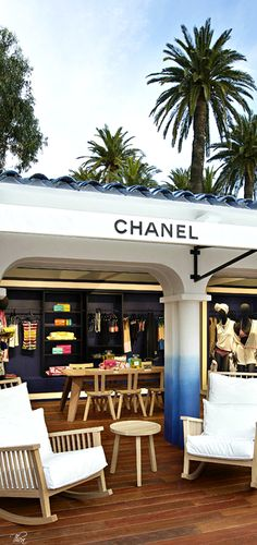 This photograph of a Chanel pop-up shop in St Tropez makes me feel like i'm on a fabulous vacation with the vibrant colors surrounded by chic white against a backdrop of a palm treed blue sky. Saint Tropez, Restaurant Hotel, La Croix Valmer, Chanel Boutique, Pop Up Shops, Luxury Shop, French Riviera, South Of France, Classy And Fabulous