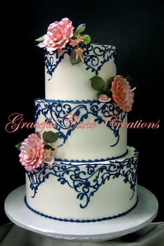 https://flic.kr/p/TXTDvg | Vintage Ivory Butter Cream Wedding Cake with Navy Blue Lace Scrolls and Blush Colored Sugar Paste Roses