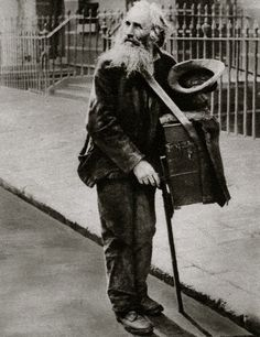 Hurdy-Gurdy Man. Characterful portraits of Londoners, believed to be by photographer Donald McLeish (1879-1950), selected from the three volumes of Wonderful London edited by St John Adcock and produced by The Fleetway House in the nineteen-twenties.