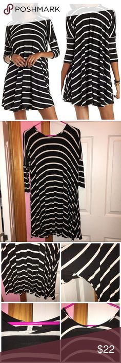 ✨LOWEST✨ Dropped Shoulder Trapeze Shift Dress Never worn; just washed. Does have a little fuzzies from wash. Crew neckline. Curved hemline. Three-quarter sleeves. Dropped shoulders. Flowy dress. Striped pattern. Material is rayon and spandex. Stock photo from Charlotte Russe. ❌NO TRADES❌ Charlotte Russe Dresses