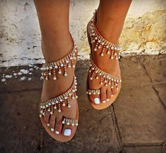 A unique combination of comfort and luxury for you who want to win all your impressions in your summer appearances!!! Α luxurious pair of sandals made by genuine leather and decorated with crystals, faux pearls !!! So glamorous all day and night long!!! Ideal sandals for a summer