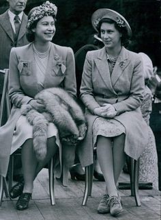 Princess Elizabeth and Her sister, Princess Margaret, photographed in 1945, when their mother, The Queen, presented service armlets to members of the Women's Land Army in Windsor Great Park.