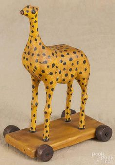Walter Gottshall, carved and painted giraffe pull toy, initialed and dated 1981, 9 1/2'' h. - Price Estimate: $75 - $150