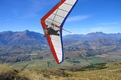 Fly with the most experienced tandem paragliding and hang gliding Company in New Zealand. Tandem flights off the highest take off in Queenstown. Queenstown New Zealand, Hang Gliding, Paragliding, Birds Eye View, Tandem, Mountain View, Golden Gate Bridge, Adventure Time, Outdoor Gear