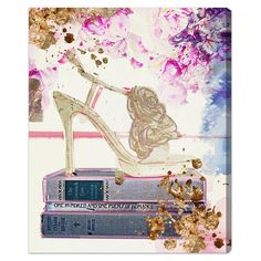 Hand-stretched canvas print showcasing a gold shoe atop stacked fashion books. Made in the USA.   Product: Canvas printC...
