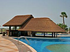 The Island World Island, Dubai - Lebanon Bamboo House Design, Minimal House Design, Patio Design, Exterior Design, Thatched House, Thatched Roof, Round House Plans, Garden Gazebo, Luxury Pools
