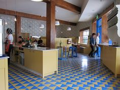 Now Open: Beachwood Cafe, Formerly the Village Coffee Shop - Squid Ink - Check out bold blue and mustard Granada Tile throughout the cafe.  Great design work by Bestor Architecture.