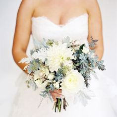 Kelly's bouquet mixed ivory dahlias and garden roses with rustic elements like eucalyptus seeds, dusty miller and pale gray accents for a te...
