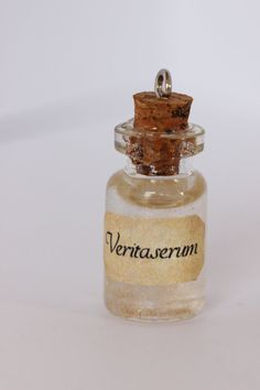 ** PLEASE READ BEFORE PURCHASE**  Three drops of this and even You-Know-Who himself would spill out his darkest secrets. The use of it on a student is — regrettably — forbidden. —Severus Snape  Veritaserum potion is mainly clear with golden swirls.  -  Bottle is approximately 1 inch tall. Contents do not move. Corks are sealed with adhesive. Each necklace comes with a silver chain (17 inches) - for a different length please leave a message in the notes with the required length.  Custom…