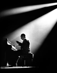 Duke Ellington photographed by Herman Leonard.  If you're a fan of jazz then chances are you've seen some of Mr. Leonard's work because he's responsible for some of the most iconic photos of jazz greats.