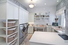 space for laundry baskets; shelves over sink, folding counter; 360-Vip Photography
