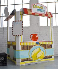Diy lemonade stand for the kids to sell lemonade in the neighborhood this summer for charity! Or just a summer activity (set this up at a garage sale!!) Cardboard Snack Shack by Build a Dream Playhouses! #zulilyfinds