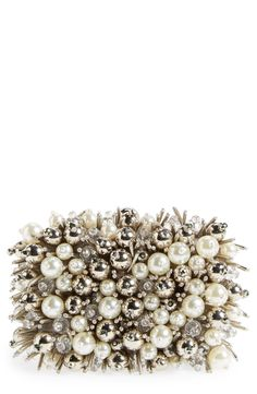 Ornate sea urchin clutch adorn with pearls and beads.