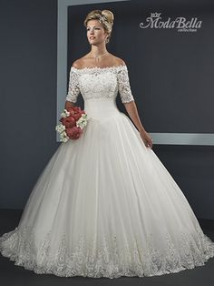 Express your happiness with this Mary's Bridal S14-3Y294 wedding dress by Moda Bella. It features an illusion, lace bodice adorned with off-the-shoulder, elbow-length sleeves, and beaded accents. This bridal gown blossoms into layers of lavish, tulle material with hem detail for an extravagant finish. Comes in Ivory or White, in sizes 2 to 30.