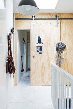To save space, the kids' bedrooms have cool plywood roller doors – they can't be slammed either! Plaque Osb, Plywood Walls, Plywood House, Plywood Interior, Pine Plywood, Slammed, Interior Office, Interior Desing, Interior Exterior