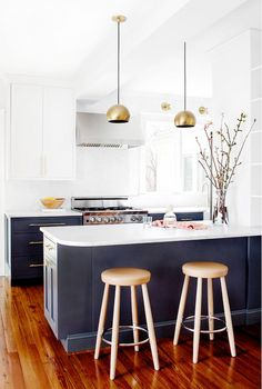 Right now we are seeing a major trend in kitchens that you may have noticed in some of our recent projects (HERE + HERE) and that is two-toned cabinets in the kitchen. Talk about a fabulous way to create a unique and custom space! We are seeing a lot of the uppers (upper cabinets) being painted white and then the lowers being painted a contrasting color or stained darker to really make the space pop. You may be thinking that this is too bold for you and you worry about it going out of style…