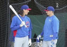 Cubs pitcher Jeff Samardzija (left) talks with Matt Garza during spring training camp at Finch Park.
