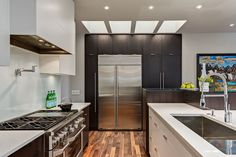 A modern kitchen with custom oak cabinetry.