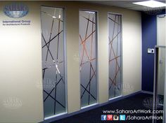 Office doors and wall inserts, made from sandblasted glass and clear design.