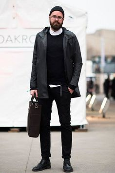 Designer and illustrator, Colin Strandberg looking sharp. All black, trench coat, button-up, handbag.