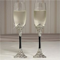 """Celebration Ebony Toasting Flutes - WeddingDepot.com - 246-FL3002 Spectacularly designed for the ultimate presentation possible, the Celebration Collection uses highly polished and intricate silver work to envoke your vision through its inherent irristable draw which will have your guests viewing these pieces with extreme admiration not only on your wedding day but also in your wedding photographs for years to come.  Set of 2 glasses measuring 10"""" tall."""