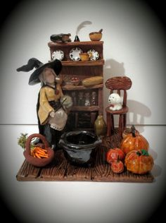 The Witches Kitchen A witch in her kitchen holding a willow wand & crystal ball next to an incense cone burner cauldron.  These can be made on request and can take up to 3 weeks to complete, they are one of a kind and personalised to the customers requirements.