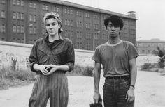 David Sylvian and Ryuichi Sakamoto in front of the Berlin Wall during the Brilliant Tress recording session, 1983. Photo by Yuka Fujii