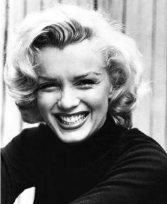 Norma Jean Baker aka Marilyn Monroe. This is an open beautiful smile.