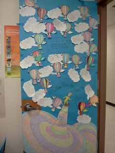 Dr. Suess Door Decorating.....Oh the Places you'll go...Children write what they want to do when they get older on a speech bubble coming from the girl or boy in the hot air balloon :)