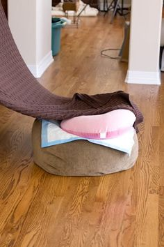 A boppy pillow to prop their heads up! Why hadn't I thought of that? Now it makes sense...