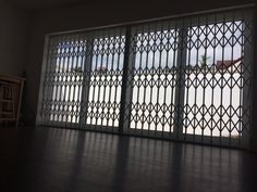 RSG1000 retractable security grilles fitted to a patio door of a residential flat in Northwood, Greater London.