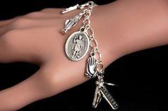Saint Expedit Bracelet. Catholic Bracelet. St Expeditus Charm Bracelet. Catholic Jewelry. Religious Bracelet. Handmade Jewelry by GatheringCharms from Gathering Charms by Gilliauna. Find it now at http://ift.tt/1UnPUEE!