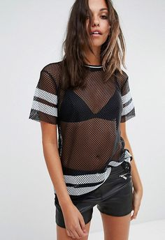 Pair with denim cut-offs and a Western belt for summer steez, or look the coolest in mom jeans and some adidas Gazelles – this mesh wonder can do no wrong. Plus, the thick stripes nod to the v catwalk-approved varsity style of the season