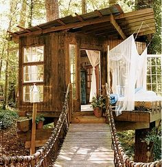 SUCH a cute treehouse for the kids!  And look at the cute little bridge that goes to it!  :)
