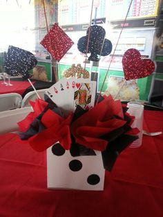 Casino party theme centerpiece:                                                                                                                                                                                 More