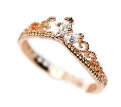 An intricately detailed ring with genuine rose gold or yellow gold plating. Fashioned with three marquise cut Cubic Zirconia stones in a Rapunzel-inpired tiara design. - Base metal: Alloy - Plating: G