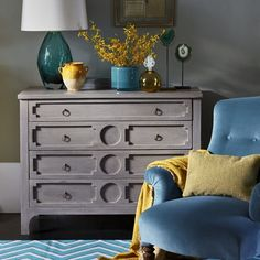 Bedroom corner with chest of drawers and teal armchair | housetohome.co.uk
