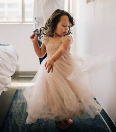 Beautiful Blush Flower girl dress, very special pattern French Lace , elegant mid fullness ,the tulle has a silk tulle like drape, rare shade of blush