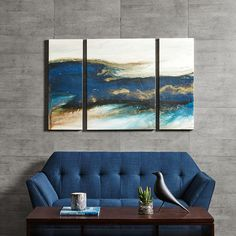 Rolling Waves is a triptych set that features a cool and tranquil abstract piece by Blakely Bering. The three piece set incorporates a deep and rich navy, crisp white, and hints of gold to give it added style. The art is printed on canvas and lightly gel coated for texture.