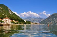 Photo about Photo of Kotor bay with cristal water and a blue sky - Kotor Bay - Montenegro - July 2010. Image of photo, adriatic, houses - 113952011