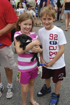 This lucky Black Labrador Mix is their new best friend! :-) Ridgewood Veterinary Hospital's Adopt-A-Pet Day.